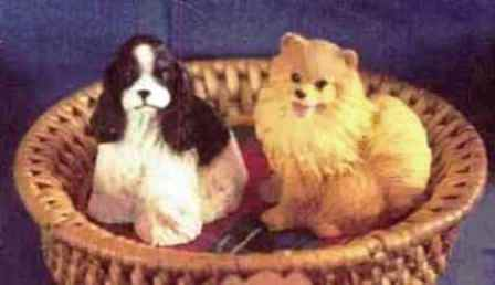 spaniel and pomeranian in basket